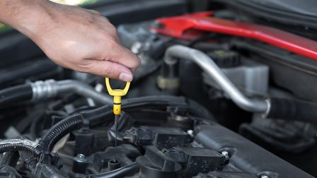 Keeping oil topped up can help keep your car running smoothly while in coronavirus lockdown. Picture
