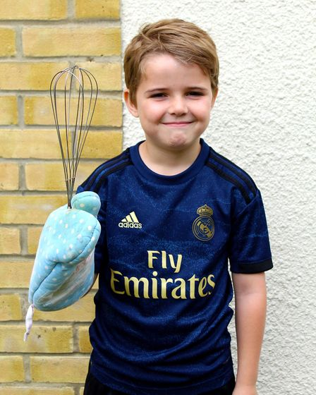 Dexter, 8, is baking cakes for friends and family to raise money for Ipswich Housing Action Group P