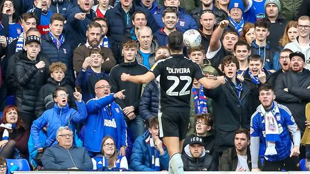 Nelson Oliveira celebrates in front of unimpressed Town fans, after putting Reading into a first hal