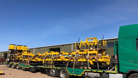 This lorry load of agricultural machinery manufactured at the Claydon factory was the third such shi
