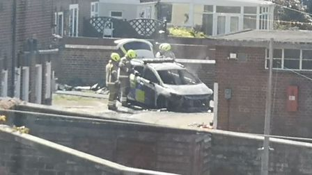 A 62-year-old man from Harwich has been charged with arson following fires in police cars at the po