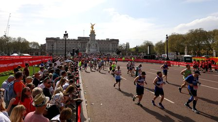 Runners head down The Mall during the 2018's Virgin Money London Marathon. Picture: Steve Paston/PA