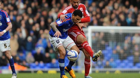 Carlos Edwards shields the ball from Kieron Dyer when the pair were playing for Ipswich Town and Mid