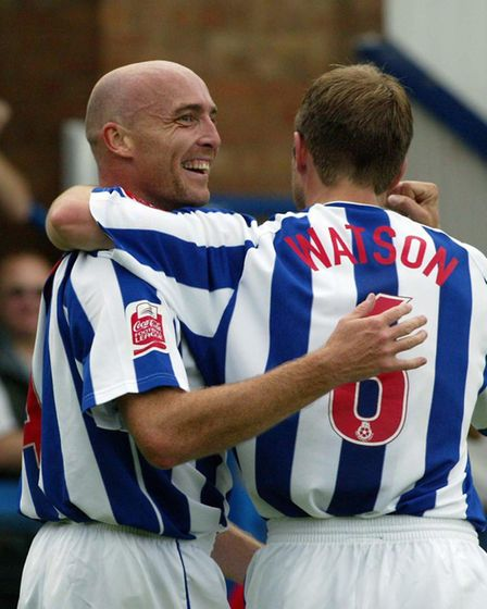 Gavin Johnson celebrates with team-mate Kevin Watson after scoring for Colchester against Doncaster