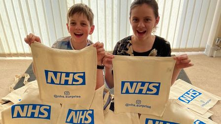 Cameron and Ella Fisher are preparing gift bags for health workers fighting Covid-19 Picture: NHS.SU