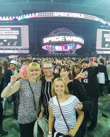Anna Bird, front in a blue-and-white top, had to wait 23 years for a Spice Girls concert Picture: AN