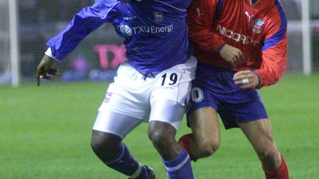 Ipswich's Titus Bramnle, left, fights for the ball with Helsingborgs' Rade Prica during the UEFA Cup