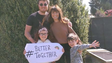 Charlie Sanderson with his wife and two children in their Essex home. Picture: CHARLIE SANDERSON