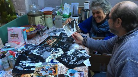 Andrew and Helen Clarke with the huge collection of theatre photos they are sorting out Picture: AND
