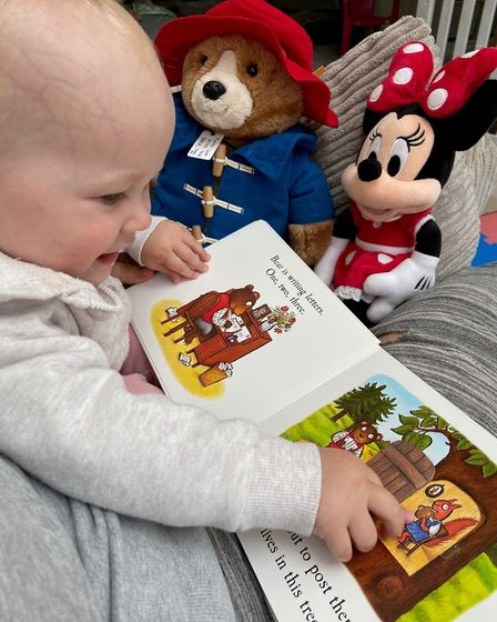 Annabel Mapperley's daughter Lillia reading to her toys Picture: Annabel Mapperley