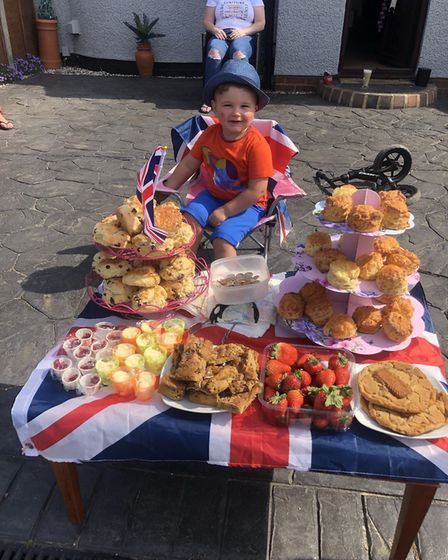 Two-year-old Arthur spent VE Day selling cakes outside his house, raising money for Ipswich foodbank