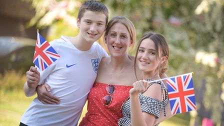 Joe, Emma and Sam Wood enjoying their street party in Sproughton Picture: SARAH LUCY BROWN
