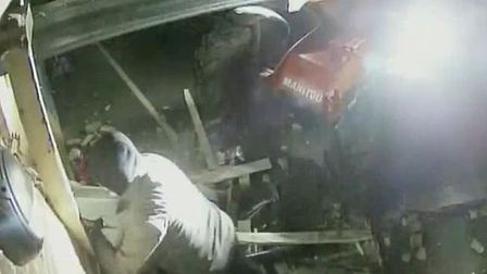 A still image from footage of the raid on the Co-op in Debenham Picture: SUFFOLK CONSTABULARY
