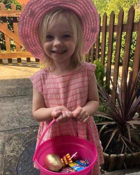 Evie wearing an Easter bonnet she made at her home in the Holywells area of Ipswich Picture: ABBIE C
