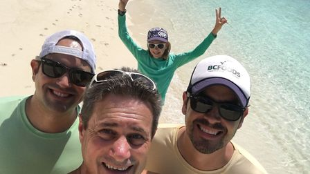 Kings of Anglia listener Chris Wright with friends Claudio and Kevin and daughter Jessica on a beach