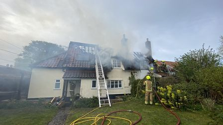 The fire tore through the roof of a thatched home in Stoke Ash Picture: IXWORTH FIRE STATION/SUFFOLK
