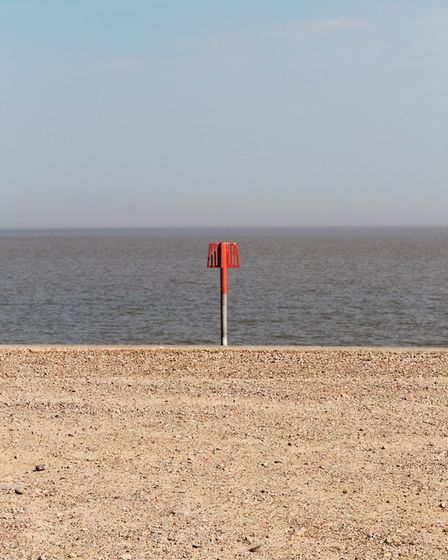 A lonely flag on Aldeburgh beach Picture: TIM DAY