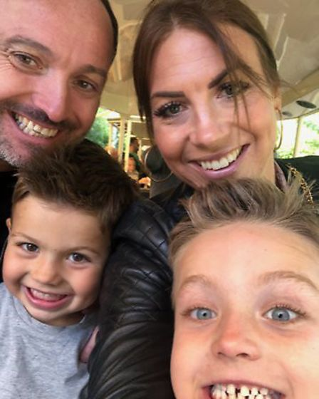 Sam Bull with her husband Dave and their two boys. Picture: SAM BULL