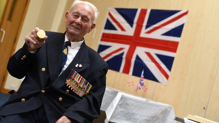 """Charles """"Sonny"""" Wright, who has died after contracting coronavirus, with his medal. Picture: SARAH"""