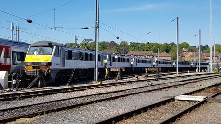 Some of Greater Anglia's Class 90 fleet stored at Norwich and waiting to be taken to a new life with