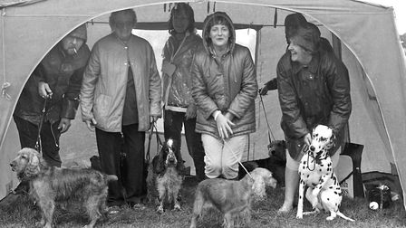From The Archives East Sheltering from the rain at Bromeswell Dog Show held in Woodbridge August 1