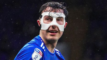 The masked man: Josh Earl pictured during the Burton Albion match. Picture Steve Waller www.steph