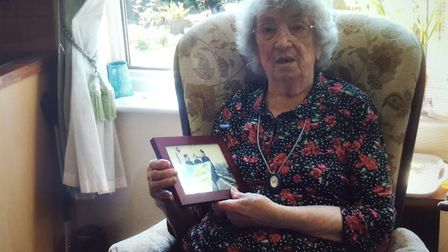 Gladys Garlick of Hadleigh with a photo of herself during the Second World War Picture: LESLEY COOK
