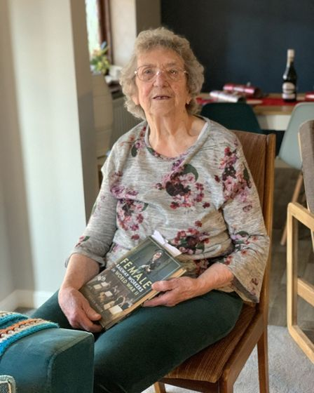 Gladys Garlick of Hadleigh with a book featuring her memories Picture: JESS EDWARDS