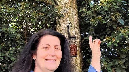 Belinda Cordey and her nest box for the great tits which had fallen in her garden and thrown the chi