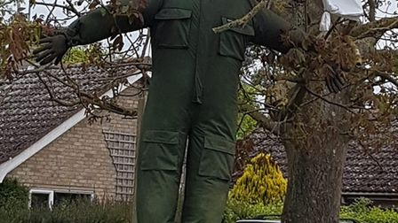 A parachuter scarecrow can be seen in the village Picture: VAL ROZIER