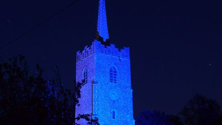 The Holy Trinity Church in Middleton has lit up blue Picture: NIGEL SMITH
