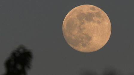This shot was taken in Ipswich as the moon began to rise on Wednesday evening Picture: PEREGRINE BUS