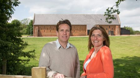 Ian and Diane Evans of Copdock Hall with their converted barn behind them. Picture: Daniel Jones/