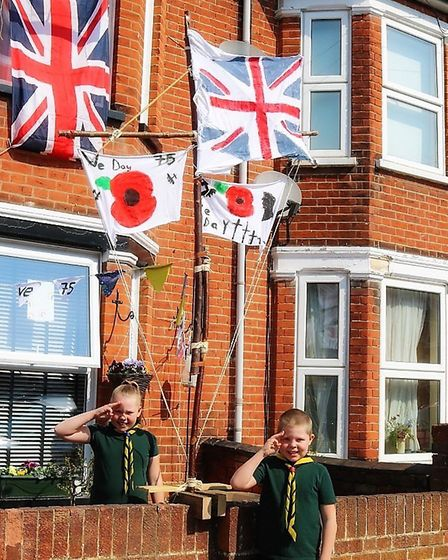 Jaycee and Ryland O'Halloran made flags for their home in Norwich Road, Ipswich. Picture: MELISSA O'