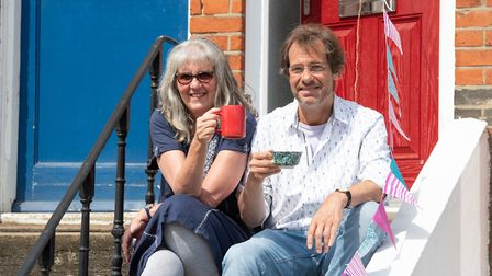 Gill and Richard Spencer enjoying a cup of tea on VE Day Picture: SARAH LUCY BROWN