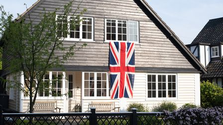 A house in Thorpeness is decorated with a flag to commemorate VE Day Picture: SARAH LUCY BROWN