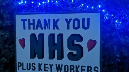 Linda Main put blue lights on a 'thank you NHS' sign outside her home. Picture: LINDA MAIN