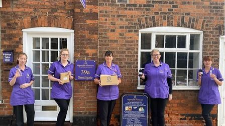 Staff at Nightingale Care Home in Beccles with their free hand sanitisers from Spectra Picture: NIG