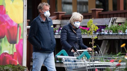 Customers wore masks as garden centres were allowed to reopen on Wednesday Picture: SARAH LUCY BROWN