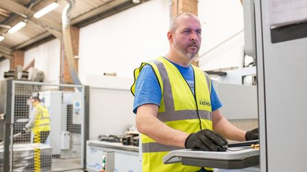 A worker on the shop floor at Thetford-based display and workspace furniture manufacturers Fathom P