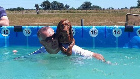 One of the dogs latching on for a piggyback ride Picture: Jo Allen / Canine Dip and Dive