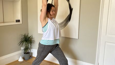 Step right leg back into warrior one pose Picture: Julia Fairbrother