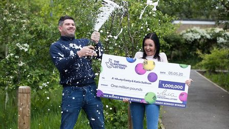 Anthony Canty celebrates with partner Katie Sullivan after he scooped a £1million prize playing the