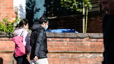 A man wears a face mask in Bolton Lane, Ipswich. Picture : SARAH LUCY BROWN