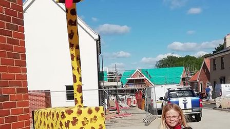 A giraffe and children outside Zoe Gobbold's house in Long Melford. Picture: ZOE GOBBOLD