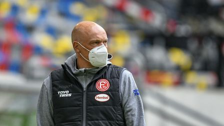 Fortuna Dusseldorf boss Uwe Rosler wearing a face mask ahead of his side's return to action in the B