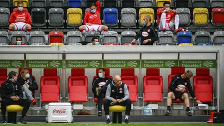 Fortuna substitutes adhere to social distancing measures behind boss Uwe Rosler Picture: AP