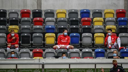 Fortuna players on the bench, wearing face masks and respecting social distancing Picture: AP