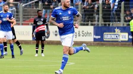 James Norwood was sporting a shaved head on his Town debut last summer. Picture: ROSS HALLS