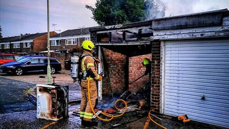 Firefighters were called to the garage in Brandon, Suffolk, in the early hours of this morning. Pict